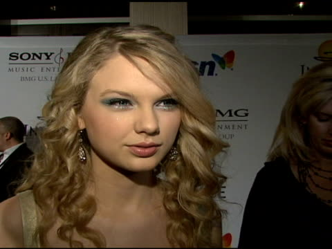 Taylor Swift on the event her success and Clive Davis at the Clive Davis 2008 PreGrammy Awards Party at NULL in Beverly Hills California on February...