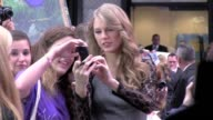 Taylor Swift signs poses for fans at Good Morning America 10/13/11