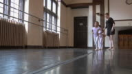 WS SLO MO Teacher instructs students (2-7) to skip during ballet class /  Chicago, Illinois, USA
