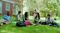 MS, PAN, teacher joining student studding on grass on campus, San Antonio, Texas, USA