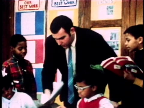 1968 MONTAGE Teacher scolding students in classroom, New York City, New York, USA, AUDIO