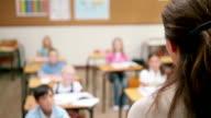 Teacher speaking to her pupils