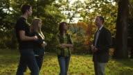 MS Teacher talking to students in park, Buena Vista, Virginia, USA
