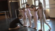 MS ZI SLO MO Teacher teaching her students (2-7) with the aid of barre / Chicago, Illinois, USA