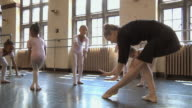MS SLO MO Teacher teaching how to bow to her students (2-7) in ballet studio / Chicago, Illinois, USA