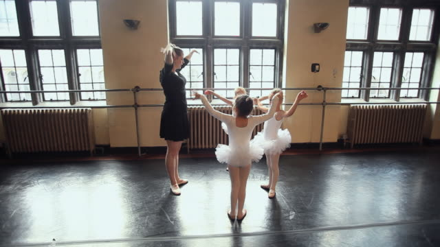 WS Teacher training students (4-7) in tutus during ballet class / Chicago, Illinois, USA
