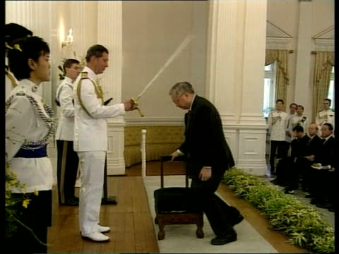 Honours LIB Prince Charles knighting man at investiture