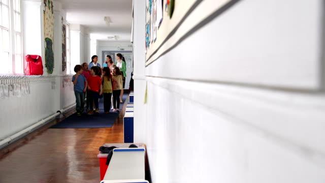 Teachers Walking Children to Class