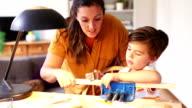 Teaching her son woodwork