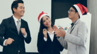 Team Business asian dancing in office