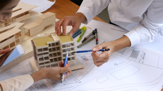 Team of architects brainstorming the design solutions, Meeting