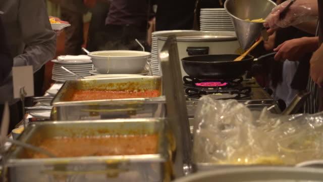 Team of chefs making spaghett