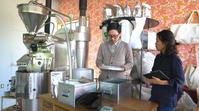 Team of coffee roasters working in their workshop