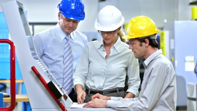 PAN Team Of Engineers Programming A CNC Machine