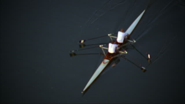 A team of two men rowing along the Schuylkill River in Philadelphia.