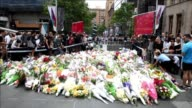 Tearful Sydney office workers and Muslim women in hijabs lay flowers at the scene of a deadly siege as an outpouring of grief and shock grips the...