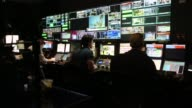 Technical directors work at a video production switcher in a production control room at the Bloomberg Television studios in New York An operator sits...