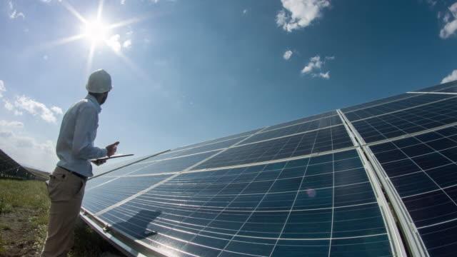Technician At Solar Power Station