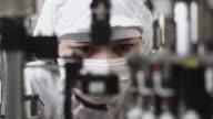 CU TU R/F Technician examining semiconductor of manufacturing machinery / Bang Pa-In, Ayutthaya, Thailand