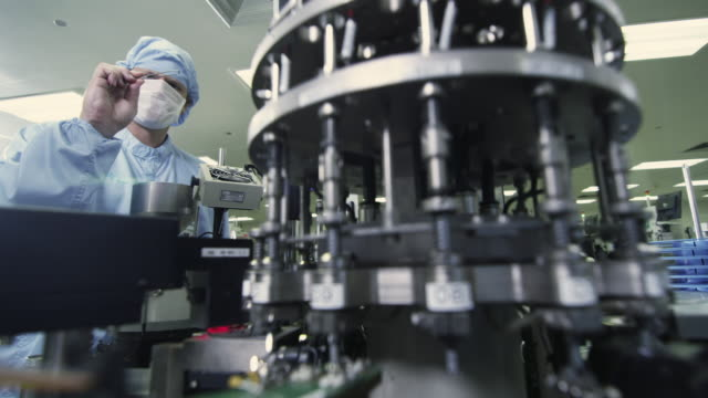 MS R/F Technician examining semiconductor of manufacturing machinery / Bang Pa-In, Ayutthaya, Thailand
