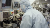 MS DS Technician inspecting newly manufactured semiconductors under microscope / Bang Pa-In, Ayutthaya, Thailand