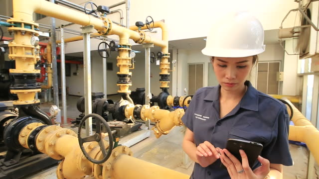 Technician inspects industrial control room