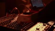 Technician operating a sound mixer, Delhi, India