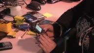 CU ZO MS Technician repairing and reprogramming smart phones / Dexter, Michigan, USA