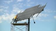 WS ZO Technician rotating photovoltaic array / Grass Lake, Michigan, USA