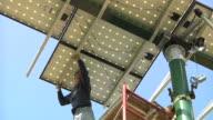 MS CS ZO Technician rotating photovoltaic array / Grass Lake, Michigan, USA