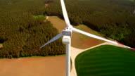 Technician worker to rope down on wind turbine