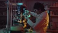 MS, Technician working in laboratory at night, London, England