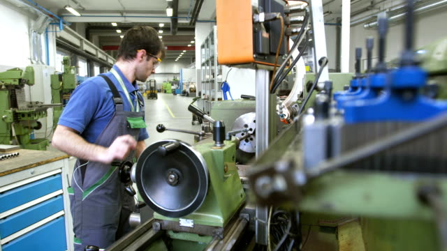 MS Technician Working On A Metal Lathe