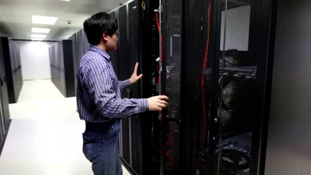 IT Technician working on a server room