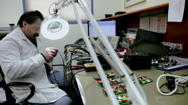 Technician works in electronics laboratory