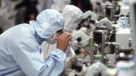 MS PAN R/F Technicians inspecting newly manufactured semiconductors under microscopes / Bang Pa-In, Ayutthaya, Thailand