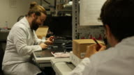 Technicians working in an electronics workshop