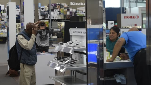 Technology and a VR headset at a Best Buy in San Francisco CA on May 19 2015 Shots shot of oculus being used by customer CU of customer trying out VR...