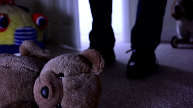Teddy bear, man leaving dark room.