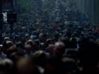 Teeming throngs of pedestrians walking along sidewalk towards camera in Manhattan Heavily crowded city scene Manhattan Street Scenes on January 01...