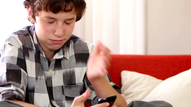 Teen boy frustrated at smartphone happenings