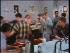 1956 teen couples dancing in soda fountain / some sitting at counter / San Francisco / educational