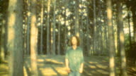 Teen Gazes at Tree Canopy and walks away into the forest / Forest Goodbye on October 01 1970 in Farmington Utah
