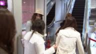 MS Teen girl distributing fliers outside clothing store, Tokyo, Japan