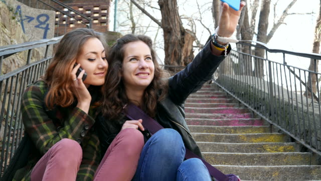 Teen girls making selfie