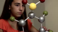 Teen Learns Science by Studying Model of a Molecule ECU