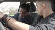 Teen listening to dad about car driving