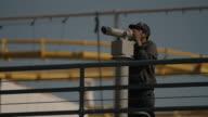 Teen looking through telescope