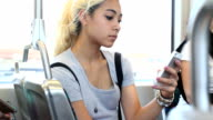 Teen on train with passengers looks up