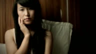 Teenage Asian girl thinking with blank expression.